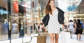 Mid adult woman walking with shopping bags